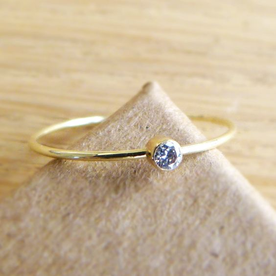Diamond Engagement Ring - Diamond Gold Ring - 14k Solid Gold. $152.00, via Etsy. Beautiful and tiny. Great for a bang-up band. Buuut possibly too nice for that.. :)