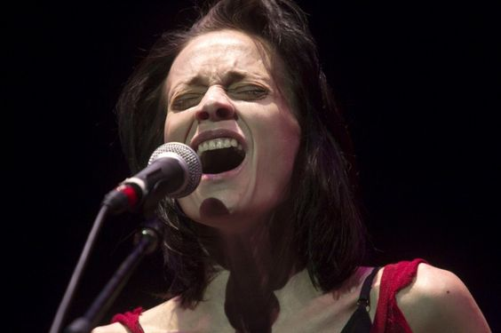 Fiona Apple closes her angel eyes and disappears in the music during a performance on Oct. 3 in Portland