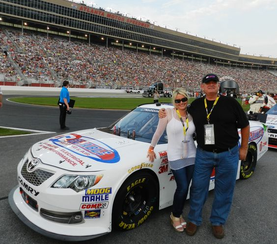 My wife and I at the Atlanta Motor Speedway our company Reliable Heating and Air Sponsored a car.