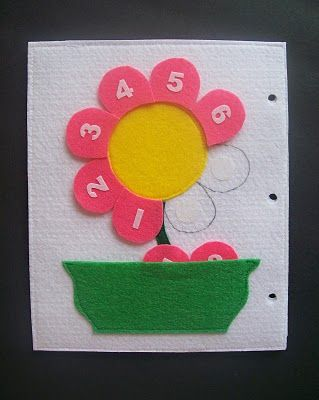 Quiet Book pages, Counting Petals. Just one page out of the book. The petals velcro on and can be placed in the flower pot pocket. You can find a supply list, instructions, and templates here.