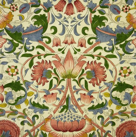 Lodden Fabric A beautiful fabric of scrolling flowers and foliage in blushed pink, green and blue on a pale cream background.