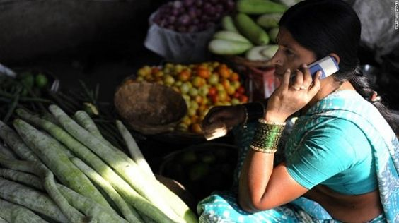 Fresh vegetables are now just a call away: A vegetable seller going about her business on her mobile phone.   www.indipin.com #indipin