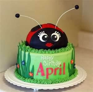 ladybug birthday cake with smaller ladybugs made of cupcake tops