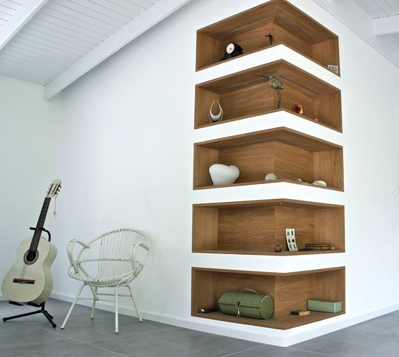 Like the idea of this as a way to give shelving an interesting focal point - without the wood though and a bolder colour in its place: