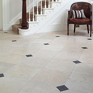 Aged cream limestone with grey hues and aged belgian blue for Carrelage design geneve
