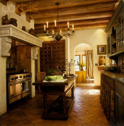 High End Spanish Style Kitchen With Antique Wood Island And Wrought Iron Chandelier Kitchen