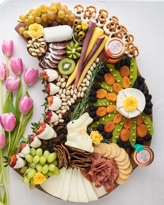 This easy DIY Charcuterie Board for Easter is perfect to serve for a crowd of your friends, family, or kids! This cheese platter is made with fresh fruit, chocolate covered strawberries, bunny candies, crackers and of course our Bee Seasonal Honey! #easterboard #charcuterieboard #beeseasonal #beeseasonalhoney