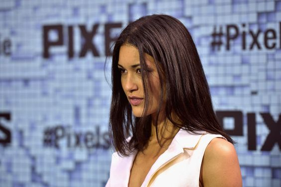 "Julia Jones Photos - Julia Jones attends the ""Pixels"" New York Premiere at Regal E-Walk on July 18, 2015 in New York City. - 'Pixels' New York Premiere - Outside Arrivals"