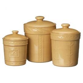 Keep your pantry organized in style with this essential design.    Product:   Small,  medium and large canister Construction Material: Stoneware    Color: Wheat Features:  Glossy, lead-free and chip-resistant      36, 48, and 80 Ounce capacity  Raised dot and olive leaf motif    Dimensions: Small: 6.5 H x 3.75 Diameter Medium: 7.5 H x 4.5 Diameter    Large: 9 H x 5.25 Diameter        Cleaning and Care: Dishwasher, microwave and oven safe
