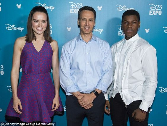Posing with the troopers: Daisy pictured here with John Boyega and president of Disney Interactive Jimmy Pitaro