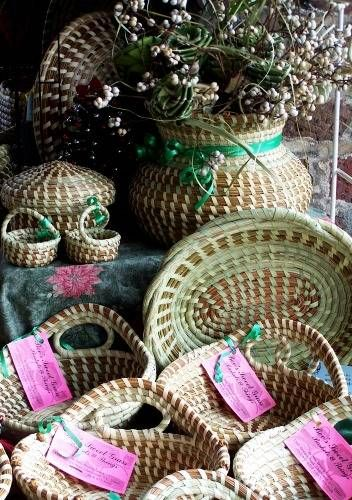 The art of Sweetgrass (or Sweet Grass) basketry is passed down through generations of Gullah families in and around Charleston, South Carolina. The baskets pictured above are from Bev's Sweet Grass Baskets & Things, Charleston.