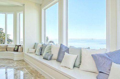 A house with lots of windows on the sea.  If I ever win the lottery, I'm donating to charity - and getting this.