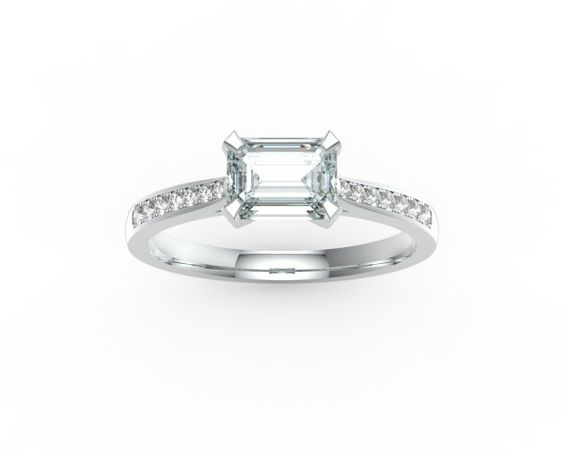 horizontal emerald cut engagement ring with band