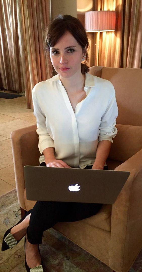 your basics: white shirt, clean face, simple hair, dark pants... and an apple computer. (c/o felicity jones)