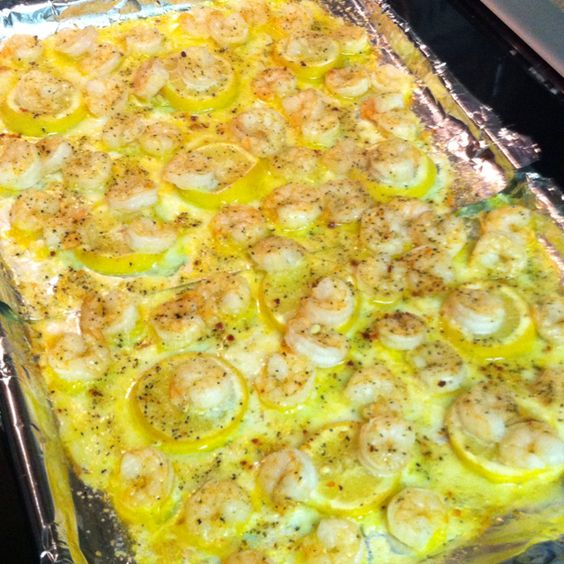 Melt one stick butter on a lined baking sheet. Slice one lemon & layer on top of butter. Place shrimp on top. Bake @ 350 for 15 mins. That's it! I broiled them on high for 5 minutes bc we like our crunchier. I love pinterest! Great with grits 8)