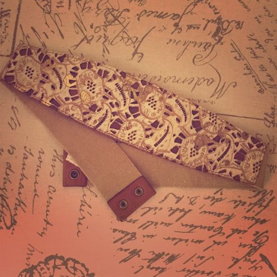 Anthropologie belt size large Beautiful belt from Anthropologie, size large. Great condition. Cream and tan with metallic gold accents on floral design. Anthropologie Accessories Belts