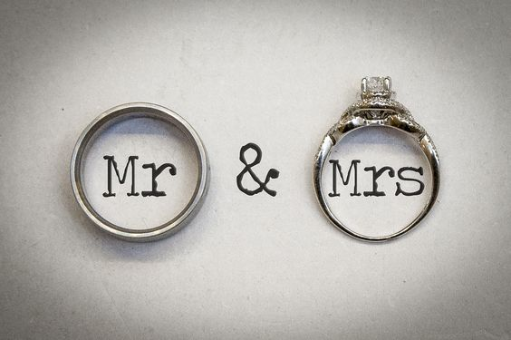 Wedding rings with Mr & Mrs in an old typewriter font.  http://www.kellygarseephoto.com