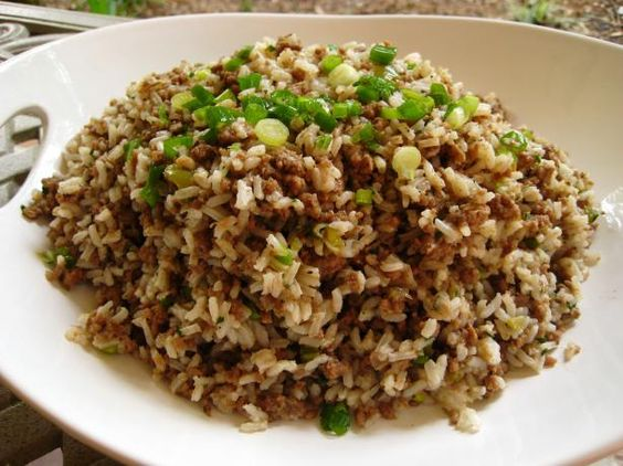 """Cajun Rice Dressing! (a.k.a. """"Dirty Rice"""")  Here's another must-have at a Cajun Thanksgiving feast. Want to make it authentic? Leave out the roux and replace it with 1lb. cooked, ground chicken livers. While you're at it, Grind up a pound of gizzards as well (the tender part) and cook it along with the other meats. Donne-moi la fourchette!  #ultimatethanksgiving"""