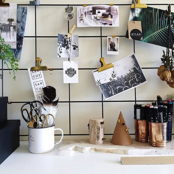 Hang a piece of gridded wire above your desk to keep pictures and inspiration visible.:
