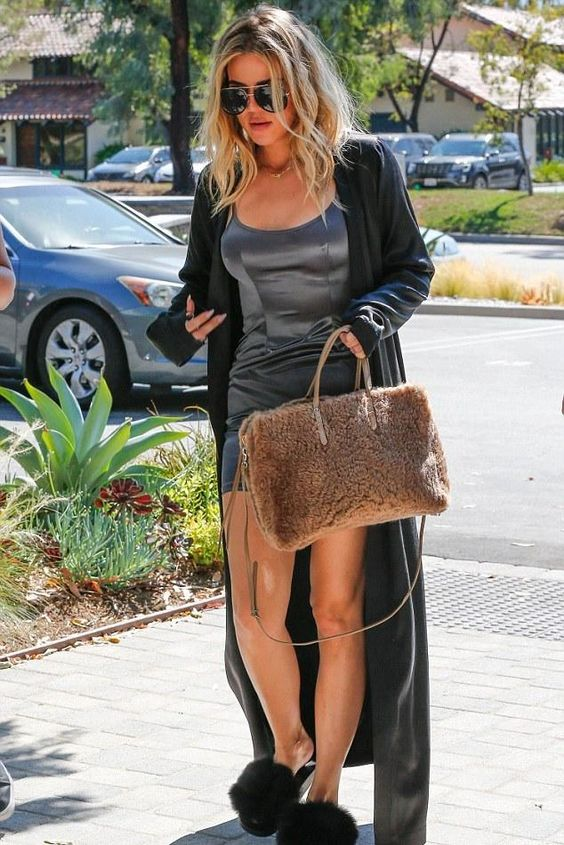 Khloe Kardashian wearing Porsche Design by Carrera 5621 Aviator Sunglasses, Givenchy Mink Fur & Rubber Slides and Mystylemode Charcoal Satin Mini Dress: