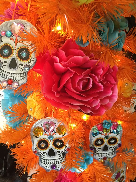 Day of the Dead inspiration for your Halloween tree! See how @cathiefilian decorated the 100% Orange Christmas Tree with DIY sugar skull ornaments and vibrant flowers.: