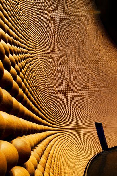 400,000 timber beads make up the acoustic panels in Fusionopolis' Genexis theatre in Singapore, designed by Kisho Kurokawa (Japan)