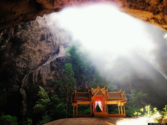 Buddhist cave temples.  This one is in Khao Sam Roi Yot National Park, Thailand