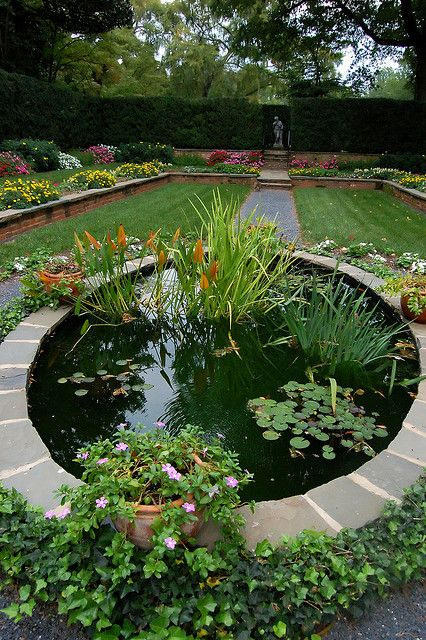 This water garden breaks up the long walkway and adds for Garden pond depth