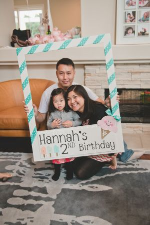 Large cardboard frame for the guests to have their photos taken for the birthday party album