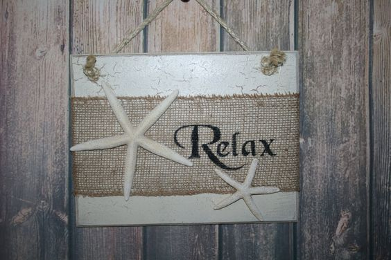 RELAX Sign, Beach Sign, Starfish Decor, Tropical Decor, Burlap Decor, Coastal Decor, Tropical Sign, Starfish Sign, Nautical Decor, Beachy, Beach House Décor This Relax burlap sign with starfish is great tropical and coastal décor for your home or beach house. Its also great for a bar or kitchen shelf....at the lake house, cottage or camp.  This wooden sign was painted soft cream over country tan and adorned with a huge 6 white starfish along with a 4 resin starfish.....over a 5 strip of…