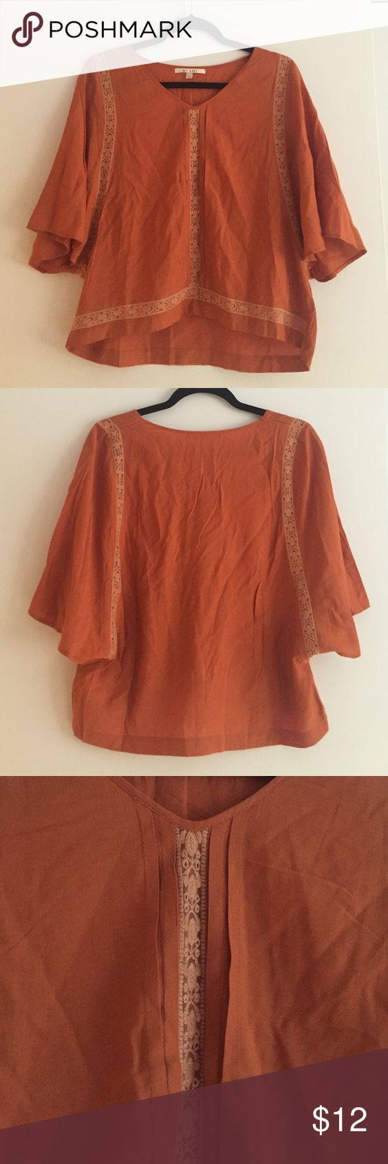 Burnt orange flowy top Originally from Francesca's (specific brand is Miami), in great condition. Fits loosely and is perfect for summer! Has lace-y details and pleated front. Francesca's Collections Tops Blouses