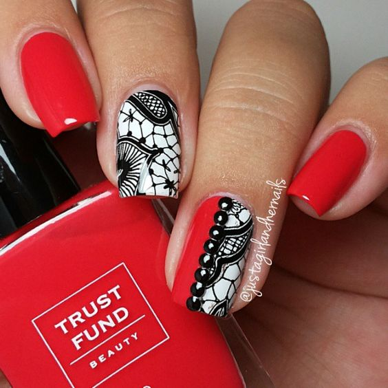Red and White Nails With Black Lace Accents.
