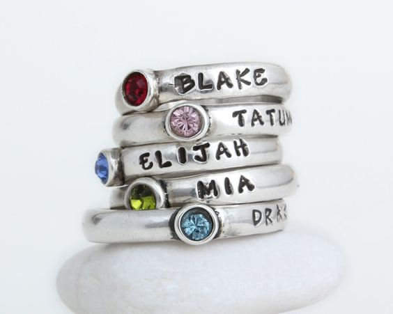 Beautiful stacking birthstone rings hand stamped with names by Nelle and Lizzy.