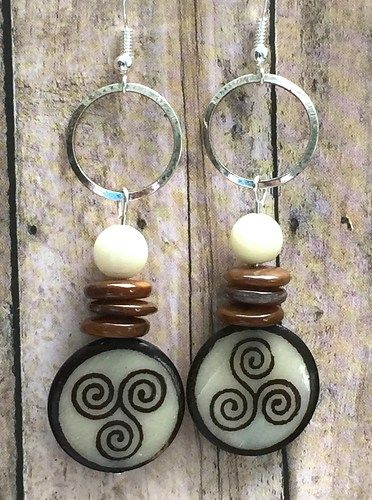 Batik Bone Triple Spiral Earrings. These are from my personal stash and parting with them is bittersweet. I hope you enjoy the triple stack of the dyed brown mother of pearl spacer beads with the shar