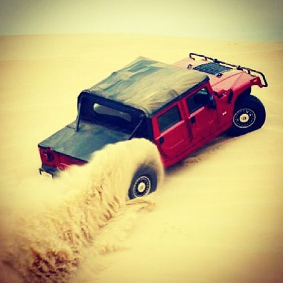 Sand trap. The driver of this Hummer could not care less.