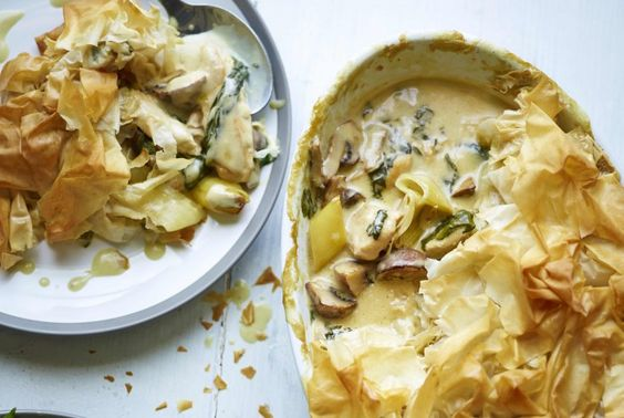 The Body Coach Chicken Pie - butter, 1 large leek, 200g mushrooms, chicken breast fillets, chicken stock, cornflour, 100ml double cream, spinach leaves, 6 sheets of filo pastry