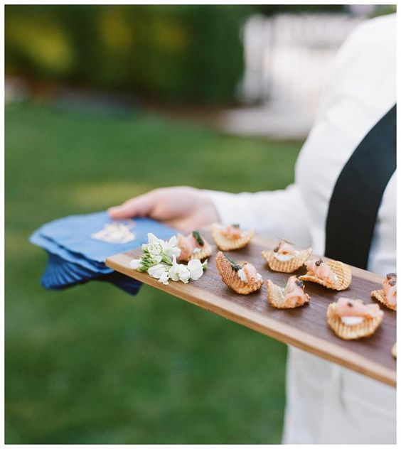 Appetizers served on wooden platters by Dupree Catering + Events. Image by Bella Grace Studios.
