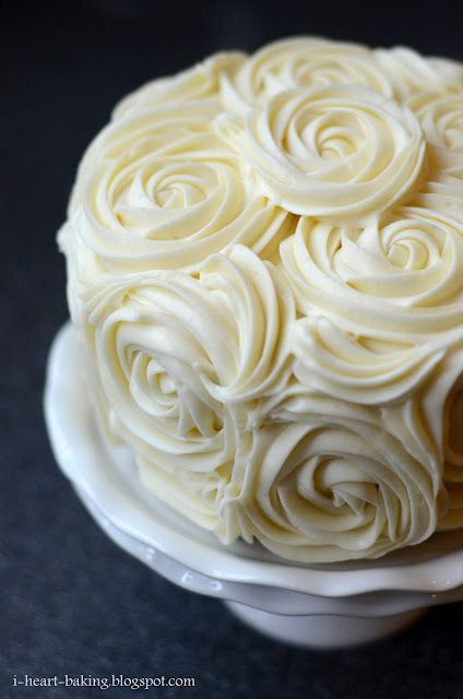 red velvet cake with cheesecake middle and cream cheese buttercream roses.. oh my lord i'm in heaven