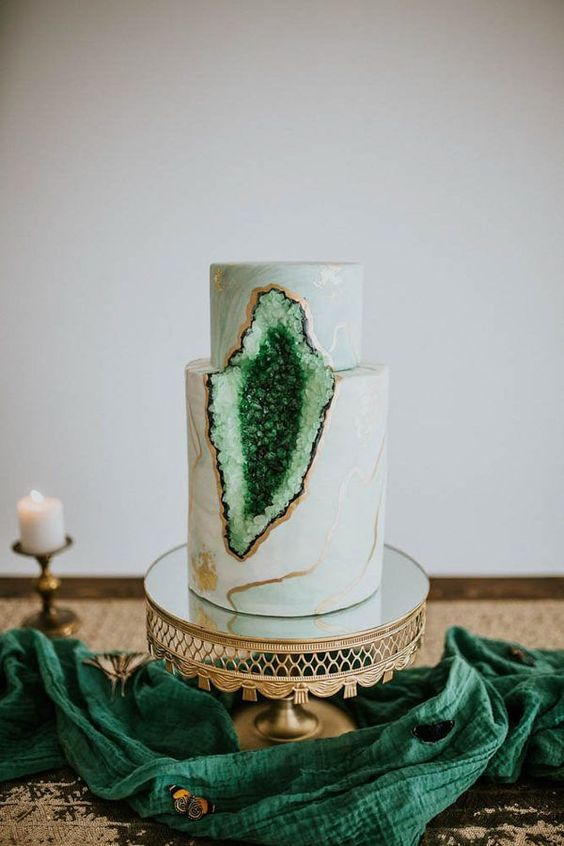 Green Geode Wedding Cake: Geodes have been one of the biggest wedding trends lately. This stunning cake merges emerald green with rock candy to create a delicious statement. | Elegant Emerald Green Wedding Details:
