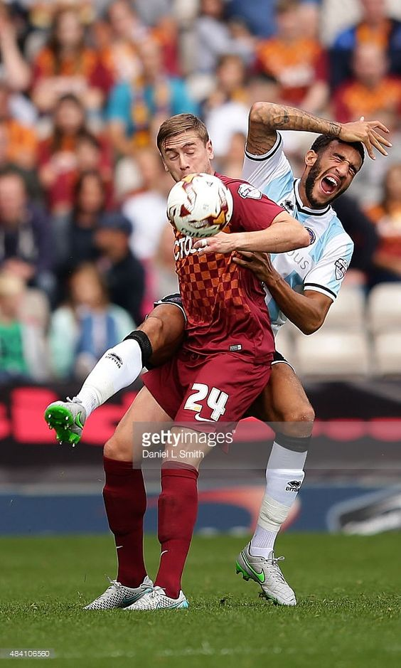 Connor Goldson of Shrewsbury Town FC smothers a header by Steven Davies of Bradford City AFC during the League One match between Bradford City AFC and Shrewsbury Town FC at Coral Windows Stadium, Valley Parade on August 15, 2015 in Bradford, England.