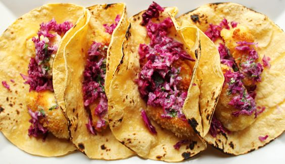 Tilapia fish tacos with red cabbage.