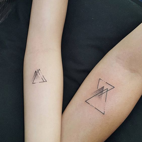 Matching geometric blackwork tattoos​ - 27 Couple Tattoo Ideas Proving That Love Is Here To Stay - OurMindfulLife.com tattoo love couple/couple tattoos creative /couple symbol tattoos /couple initial tattoos /couple tattoos unique /tattoo couple wedding /romantic couples tattoos /couple tattoos infinity //matching tattoos for couple/matching tattoos for couples quotes/couple finger tattoo/couple tattoos king and queen/couple crown tattoo designs/couple tattoo ideas/ couple tattoo quotes