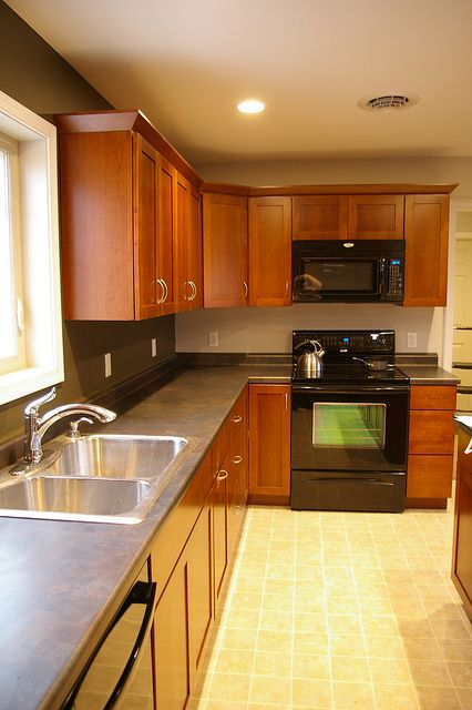 yellow kitchen dark cabinets kitchen black appliances black countertops and top of 1691
