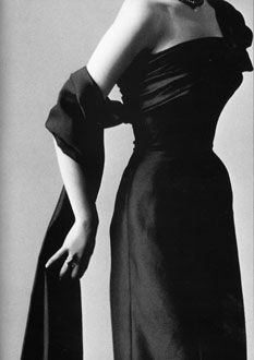 """Christian Dior Haute Couture, 1953. The """"New Look"""", before 1950s when WWII was going on, women were wearing jeans, cheap and utility fabric. But until 1950s """"The New Look"""" brought back the feminine to the women. This is why i choose the picture."""