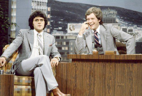 Leno is the guest while Letterman fills in for Carson on the Tonight Show.