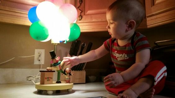 My grandson with his Daddy's nursery lamp, now his!   ♡