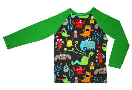 Auf dem Shirt haben sich viele lustige Monster versammelt. Mal wieder eine geniale Eigenproduktion von stoffwelten.