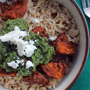 Spiced acorn squash is paired with a bright green jalapeño pesto in this easy to prepare winter dish.
