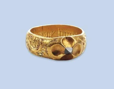 "A RARE LATE MEDIEVAL DIAMOND RING The ring of band design, the upper part of the ring engraved with flowers and showing traces of blue enamel, centering an octahedral diamond within a quatrefoil mounting, inner engraving ""En Bonne Heure"" 15th Century"