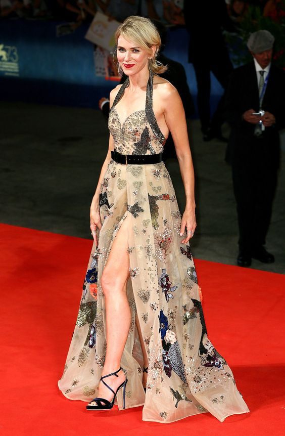 NAOMI WATTS dares to bare in an embroidered Elie Saab Haute Couture gown with a thigh-high slit and Jimmy Choo accessories at the premiere of The Bleeder.
